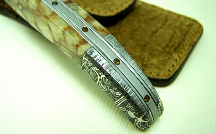 Couteau St Fleuret manche ebene ressort forgé ciselé sertie d'une Améthyste