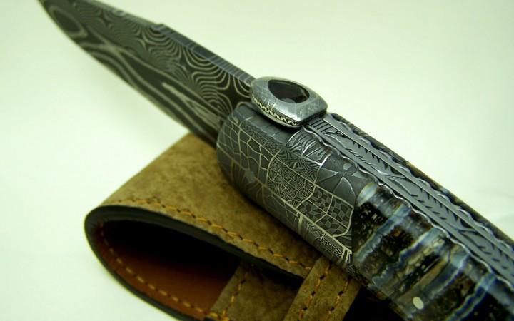 Couteau d'art CL02 lame damas forgée manche molaire de mammouth et quartz