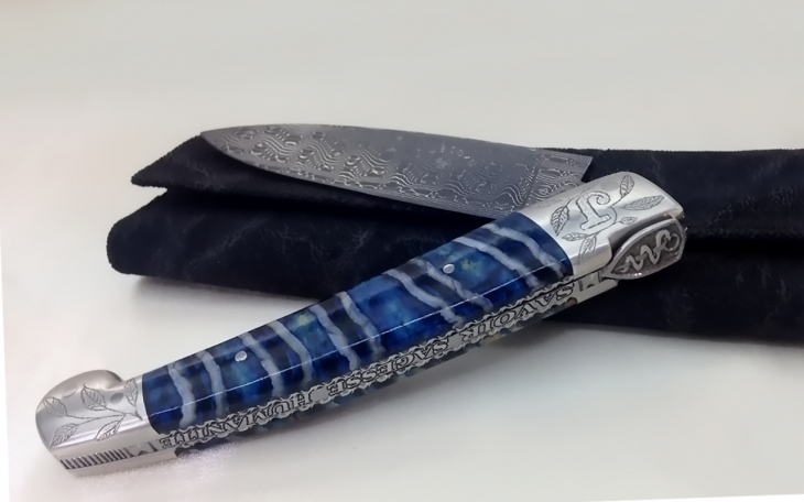 Couteau CL01 motif caducée ressort forgée gravé manche molaire de mammouth