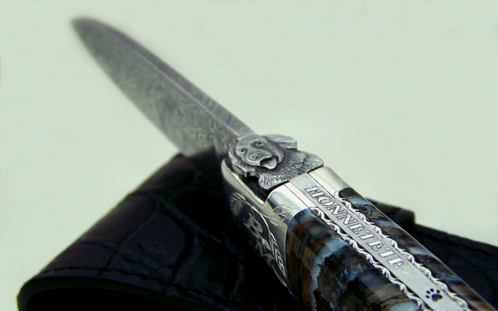 Art knife dog motif lion of occitanie handle in molar of mammoth and mitres silver 925