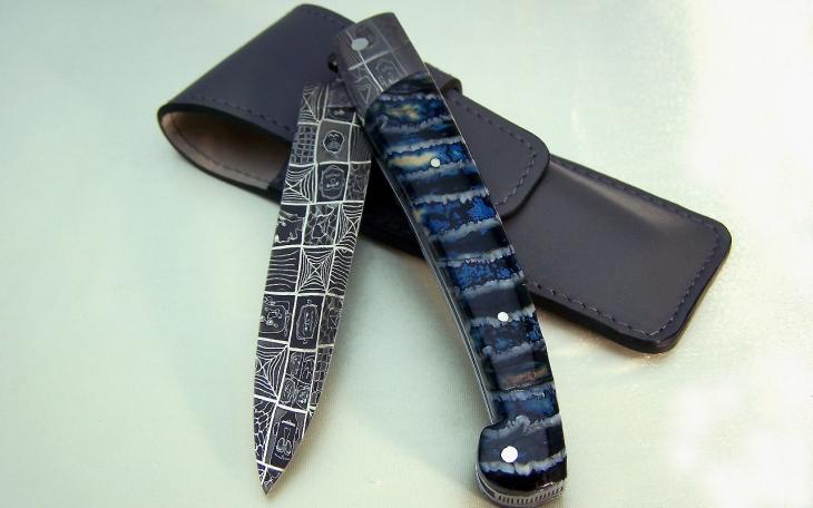 Couteau d'art CL01 ressort ciselé manche molaire de mammouth